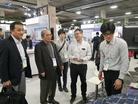 President Yokoya and Executive Director/Director General Watanabe at the NAIST booth